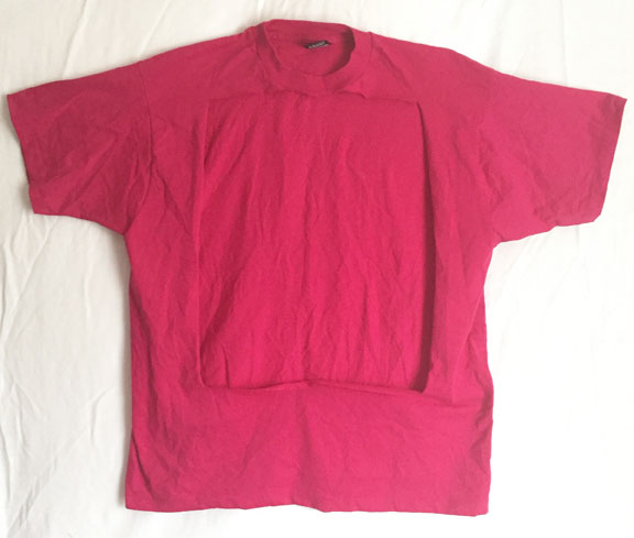 Pink shirt with front design cut out.