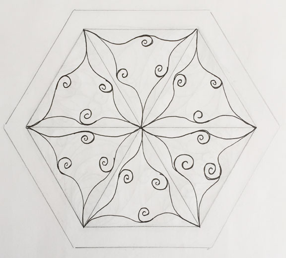 Hand drawing in black ink of a swirling quilting motif inside a hexagon